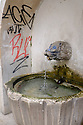Lisbon, Portugal. 21.03.2015. a graffitoed water fountain in the Alfama district of Lisbon. © Jane Hobson.