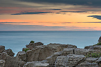 Photo of Pancake Rocks at sunrise, limestone formations on wild coast in Punakaiki, Paparoa National Park, West Coast, New Zealand