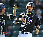 Photo of the Furman University Paladins in a game against the Michigan State Spartans on Saturday, March 14, 2015, at Fluor Field at the West End in Greenville, South Carolina. Furman won, 11-9. (Tom Priddy/Four Seam Images)