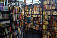 Customers browse the books at the St. Mark's Book Store in the East Village neighborhood of New York. (© Richard B. Levine)