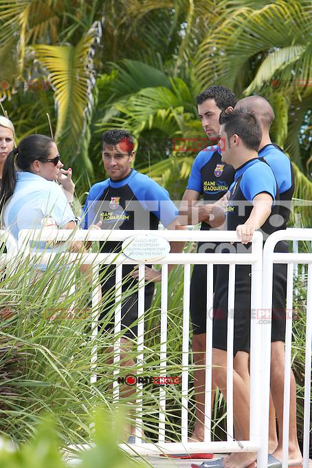 Víctor Valdés Arribas, David Villa Sanchez, Sergio Busquets Burgos and Xavier Hernandez Creus of FC Barcelona visit the Miami Sea Aquarium in Miami, Florida. August 2, 2011. © MPI40 / MediaPunch Inc.
