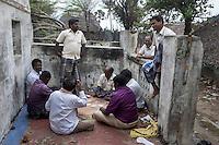 Fishermen playing card at a Tsunami (2004) destroyed house at Akerapett in Nagapattinam, Tamil Nadu, India.