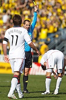 27 MARCH 2010:  Referee Mark Geiger issues a yellow card to Martin Saric of Toronto FC (25) during the Toronto FC at Columbus Crew MLS game in Columbus, Ohio on March 27, 2010.
