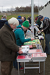 Edinburgh University 3 Selkirk 2, 13/03/2016. Peffermill, Scottish Lowland League. 'Groundhoppers' browsing souvenirs before watching Edinburgh University taking on Selkirk in a Scottish Lowland League match at Peffermill, Edinburgh in a game the hosts won 3-2. The match was one of six attended by members of GroundhopUK over the weekend to accommodate groundhoppers, fans who attempt to visit as many football venues as possible. Around 100 fans in two coaches from England participated in the 2016 Lowland League Groundhop and they were joined by other individuals from across the UK which helped boost crowds at the six featured matches. Photo by Colin McPherson.