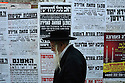 An elderly ultra orthodox Jewish man walks past posters protesting the upcoming gay parade in Jerusalem. Mea Shearim, Jerusalem, Israel