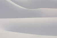 Annual snowfall in most of Yellowstone averages 150 inches. At its peak, the snow and wind create intriguing snow abstract sculptures.