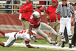 James Montgomery (#21), Washington State running back, gets tackled along the sidelines during the Cougars non-conference overtime 30-27 victory over SMU at Martin Stadium in Pullman, Washington, on September 19, 2009.