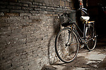 Bicycle against a wall, Yangzhou, China, a suburb city of Shanghai and major producer of photovoltaic cells for solar power.