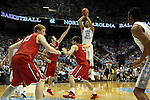 21 December 2013: North Carolina's J.P. Tokoto (13, white) takes a shot. The University of North Carolina Tar Heels played the Davidson College Wildcats at the Dean E. Smith Center in Chapel Hill, North Carolina in a 2013-14 NCAA Division I Men's Basketball game. UNC won the game 97-85 in overtime.