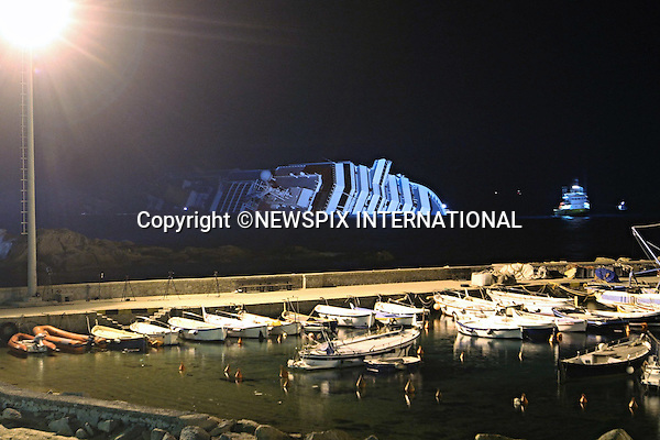 "Isola di Giglio, Italy_17/01/2012:  COSTA CONCORDIA CRUISE TRAGEDY.The luxury cruise ship Costa Concordia, that ran aground on Friday night near Isola del Giglio..The Costa Concordia which was carrying 4,200 people, experienced trouble a few hundred metres from the tiny Tuscan holiday island of Giglio on Friday evening as the passengers were at dinner, after apparently sailing off course..Mandatory Credit Photo: ©Bramo/NEWSPIX INTERNATIONAL..**ALL FEES PAYABLE TO: ""NEWSPIX INTERNATIONAL""**..IMMEDIATE CONFIRMATION OF USAGE REQUIRED:.Newspix International, 31 Chinnery Hill, Bishop's Stortford, ENGLAND CM23 3PS.Tel:+441279 324672  ; Fax: +441279656877.Mobile:  07775681153.e-mail: info@newspixinternational.co.uk"