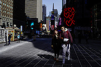 People walk along Times Square during low temperatures in New York. 16.02.2015. Eduardo Munoz Alvarez/VIEWpress.