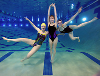 NWA Democrat Gazette/SPENCER TIREY Haas Hall Bentonville swimmer Hayley Pike, from left , Fayetteville High School diver Lindsey Rissinger and Bentonville High School swimmer Taylor Pike pose, Tuesday March 7, 2017, at the bottom of the Bentonville Community center's pool. The Northwest Arkansas Democrat-Gazette sports writers named Hayley Pike, girls newcomer of the year, Rissinger, girl diver of the year and Taylor Pike girls swimmer of the year.