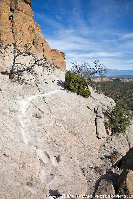The trail at Tsankawi, a part of Bandelier National Monument near Los Alamos, New Mexico, is worn from the passage of thousands of hikers walking through the soft volcanic rock.