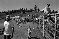 Spectators leave the rodeo grounds after the annual Lincoln Rodeo in Lincoln, MT in June 2006.  The Lincoln Rodeo is an open rodeo, which means competitors need not be a member of a professional rodeo association.