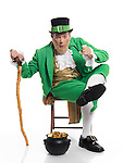 Leprechaun in bright green clothes holding a smoking pipe in his hand. Isolated on white background.