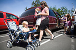 Sharon Ferrell carries James to join Ivy in the stroller, while she takes Bea and Vivian to the library in Auburn, CA  May 13, 2009.