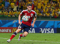 A large bug flies toward James Rodriguez of Colombia before landing on him