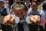 Palestinians take part in a protest to show solidarity with Palestinian prisoners on hunger strike in Israeli jails, in Gaza city on April 27, 2017. Photo by Ashraf Amra