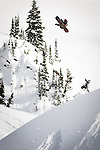 Curtis Ciszek hits a big jump in the backcountry near Revelstoke, BC