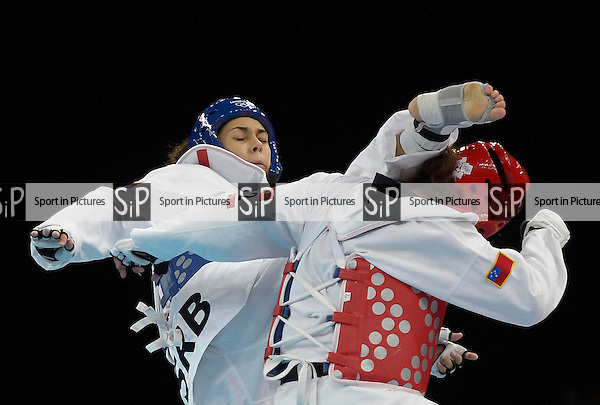 Malica Mandic (SRB, Serbia, blue) and Talitiqa Crawley (SAM, Samoa). taekwondo - PHOTO: Mandatory by-line: Garry Bowden/SIP/Pinnacle - Photo Agency UK Tel: +44(0)1363 881025 - Mobile:0797 1270 681 - VAT Reg No: 768 6958 48 - 10/08/2012 - 2012 Olympics - Aquatics Centre, Olympic Park, London, England