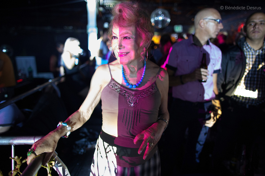 "September 2, 2012 - Mexico City, Mexico - Samantha dances at a nightclub in Mexico City. Samantha Flores is an 80-year-old transgender woman from Veracruz, Mexico. She is a prominent social activist for LGBTQI rights and is the founder of the non-profit organization ""Laetus Vitae"", a day shelter for elderly gay people in Mexico City. Senior citizens in general are many times prone to neglect and abandonment by their families, leaving them all but invisible. Their plight can be even worse if they are homosexual. Photo credit: Bénédicte Desrus"