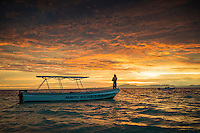 Namotu Island, Fiji (Tuesday, June 9, 2015) Boat driver Aporosa Nalima (FJI) Pre Dawn - A third consecutive lay day was called at the Fiji Pro today, stop No. 5 on the 2015  WSL Championship Tour, with only small and Inconsistent 2' surf surf on offer at Cloudbreak and a projected swell due to arrive later this week.<br /> the swell was expected to dip down, which it did, so competition was called off. The swell was expected to build over the next few days and provide really good conditions into the weekend.   Photo: joliphotos.com