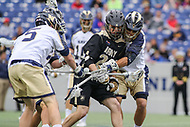 Annapolis, MD - April 15, 2017: Army Black Knights Gunnar Miller (24) gets the ball knocked out of his stick by Navy Midshipmen defenders during game between Army vs Navy at  Navy-Marine Corps Memorial Stadium in Annapolis, MD.   (Photo by Elliott Brown/Media Images International)