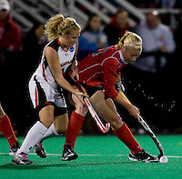 Harriet Tibble (23) of Maryland fights for the ball with Danica Deckard (23) of Ohio State during the NCAA Field Hockey Championship semfinals in College Park, MD.  Maryland defeated Ohio State, 3-1.