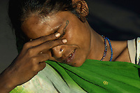 Faces of Mumbai India, covering her face due to the afternoon light? Or is it shyness, Indian women near the Bollywood area,Mumbai, India
