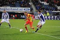 VOETBAL: ABE LENSTRA STADION: HEERENVEEN: 30-11-2013, SC Heerenveen - Go Ahead Eagles, uitslag 3-1, Jeffrey Rijsdijk (#10 | GAE), Marten de Roon (#15 | SCH), ©foto Martin de Jong