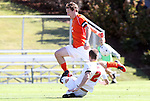 10 November 2010: Maryland's Taylor Kemp (2) tackles the ball from Clemson's Tommy Drake (9). The University of Maryland Terrapins defeated the Clemson University Tigers 2-1 at Koka Booth Stadium at WakeMed Soccer Park in Cary, North Carolina in an ACC Men's Soccer Tournament Quarterfinal game.
