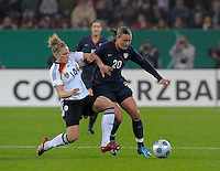 Abby Wambach (20) dribbles against Kim Kulig (14). US Women's National Team defeated Germany 1-0 at Impuls Arena in Augsburg, Germany on October 27, 2009.