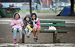 Afghan refugee children sit on a bench in a city park in Belgrade, Serbia. The park has filled with refugees from several countries stopping over on their way to Germany, Sweden, Holland, and elsewhere. <br /> <br /> Parental consent obtained.
