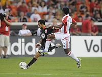 D.C. United forward Dwayne de Rosario (7) makes a pass against Toronto FC midfielder Julian de Guzman (6). D.C. United defeated Toronto FC 3-1 at RFK Stadium, Saturday May 19, 2012.