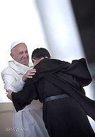 Pope Francis kiss the palm of the hands to newly ordinated priests during of a weekly general audience at St Peter's square in Vatican. on June 15, 2016