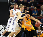 Northern Iowa Seth Tuttle, left, and Nate Buss, behind, guards Wyoming's larry Nance (22) 2015 NCAA Division I Men's Basketball Championship March 20, 2015 at the Key Arena in Seattle, Washington.    Northern Iowa beat Wyoming 71 to 54.   ©2015.  Jim Bryant Photo. All Rights Reserved.