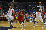 Ole Miss' Derrick Millinghaus (3) vs. Florida's Mike Rosario (3) in the SEC championship game at Bridgestone Arena in Nashville, Tenn. on Sunday, March 17, 2013.