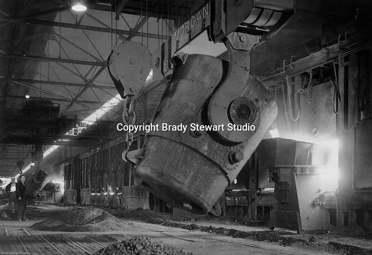 Monessen PA:  View of the charging of open hearth furnaces at the Pittsburgh Steel Company plant.<br />