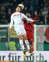 FUSSBALL  DFB-POKAL  ACHTELFINALE  SAISON 2012/2013    FC Augsburg - FC Bayern Muenchen        18.12.2012 Koo Ja Cheol  (li, FC Augsburg) gegen David Alaba (FC Bayern Muenchen)