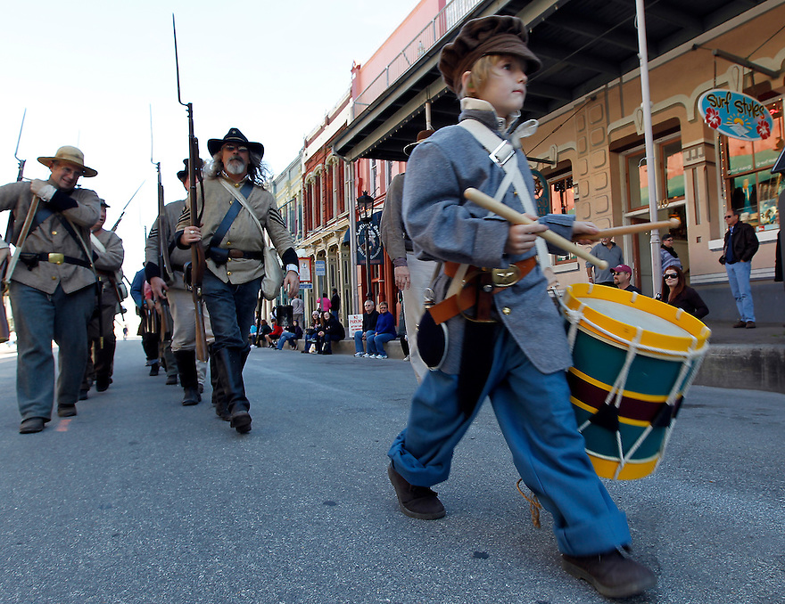 William Waldrip, 7, leads Confederate troops during a Battle of Galveston reenactment on the Strand in Galveston, Texas on Saturday, Jan. 14, 2012. The Battle of Galveston Reenactment was part of a series of events marking the 149th anniversary of the Civil War Battle of Galveston, in which Confederate troops regained control of Galveston Harbor.