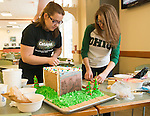 Dana Wright (Let) and Samantha Goble contruct Residential Housings entry into this years gingerbread house decoation competiion. Photo by Ben Siegel