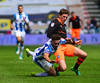 Huddersfield Town's Tommy Smith is fouled by Sheffield Wednesday's Adam Reach<br /> <br /> Photographer Andrew Vaughan/CameraSport<br /> <br /> The EFL Sky Bet Championship Play-Off Semi Final First Leg - Huddersfield Town v Sheffield Wednesday - Saturday 13th May 2017 - The John Smith's Stadium - Huddersfield<br /> <br /> World Copyright &copy; 2017 CameraSport. All rights reserved. 43 Linden Ave. Countesthorpe. Leicester. England. LE8 5PG - Tel: +44 (0) 116 277 4147 - admin@camerasport.com - www.camerasport.com