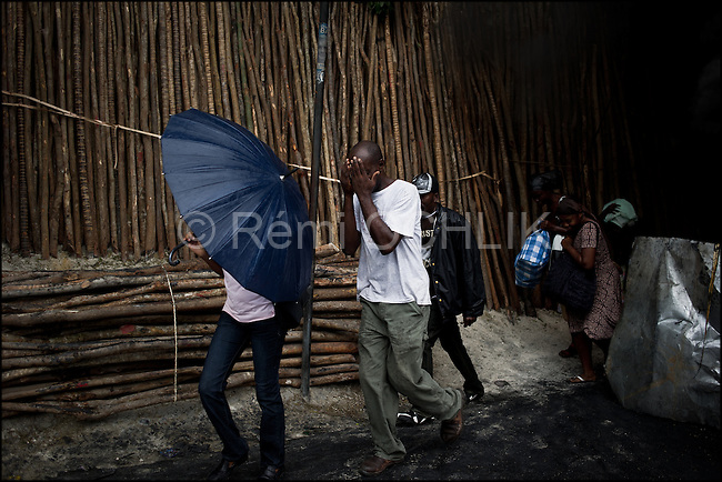 &copy; Remi OCHLIK/IP3 - Port au Prince on 2010 december 9 - PORT-AU-PRINCE -- Clashes and shooting were reported Thursday in Haiti's capital for a second day as demonstrators staged a march to protest what they said was election fraud in the Nov. 28 presidential elections..The protests broke out Wednesday after election officials announced Tuesday night that two candidates had made it into a runoff: Mirlande Manigat, a former first lady, and Jude C&Egrave;lestin, the candidate of current President Ren&Egrave; Pr&Egrave;val's party. Out of the running was Michel &quot;Sweet Micky'' Martelly, who early results had shown running second. - Martelly supporters demonstrate in Petion Ville and set up roadblocks on Delmas street.