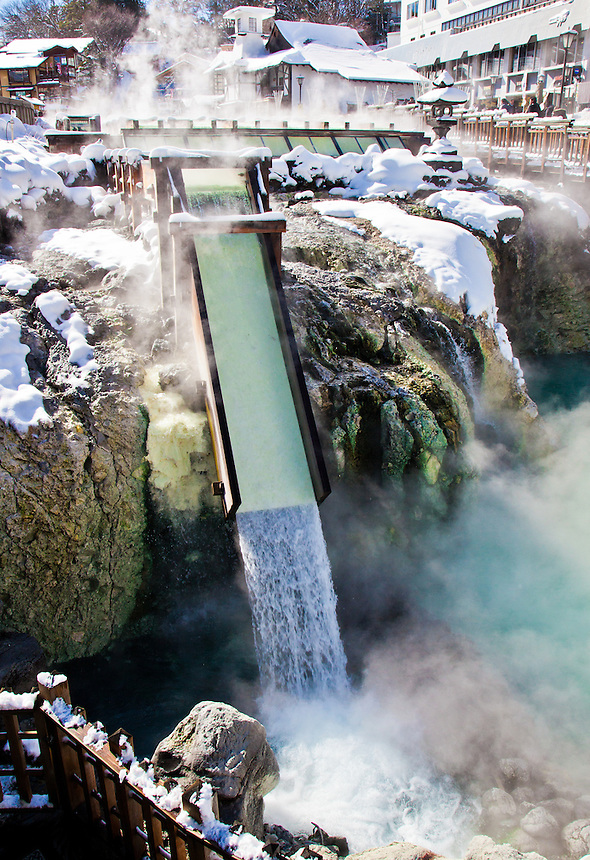95 degree Celsius water pours out of the ground at Kusatsu Japan`s most popular hot spring resort shown here with winter snow.