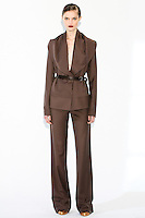 Model wears a draped lapel jacket, flared leg trousers, tank camisole, and illusion belt, by Fiona Cibani, for the Ports 1961 Pre-Fall 2011 L'heure bleue collection, December 8, 2010.