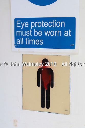 Sign on the gents' toilet door, Able Skills, Dartford, Kent.
