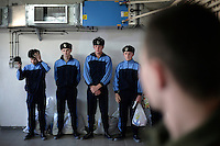 New conscripts wait to be sent to their living quarters. This year's class of drafted recruits is the final one after 90 years of compulsory military service, as Poland's army turns professional in 2009.