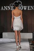Model walks runway in The Morgan wedding dress by Anne Bowen, for the Anne Bowen Bridal Spring 2012 runway show.