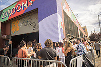 Thousands of millennials descend on the Bushwick neighborhood of Brooklyn to take in the experiential 29 Rooms installation on Sunday, September 11, 2016. The exhibit by the women's lifestyle website Refinery29 is a social media spectacle with art and culture themed rooms designed with selfies in mind. The installation was wildly popular, in part due to the social media aspect, so popular that the line was cut off at noon, hours before the last entry. (© Richard B. Levine)