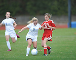 Oxford High's Ali McGee (10) vs. Lafayette High's Lizzie Gardner (5) in girls high school soccer in Oxford, Miss. on Saturday, December 8, 2012. Oxford won 1-0.